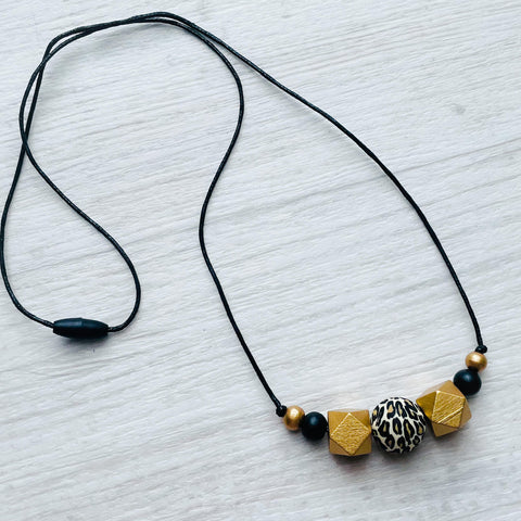 corded necklace - Snow Leopard