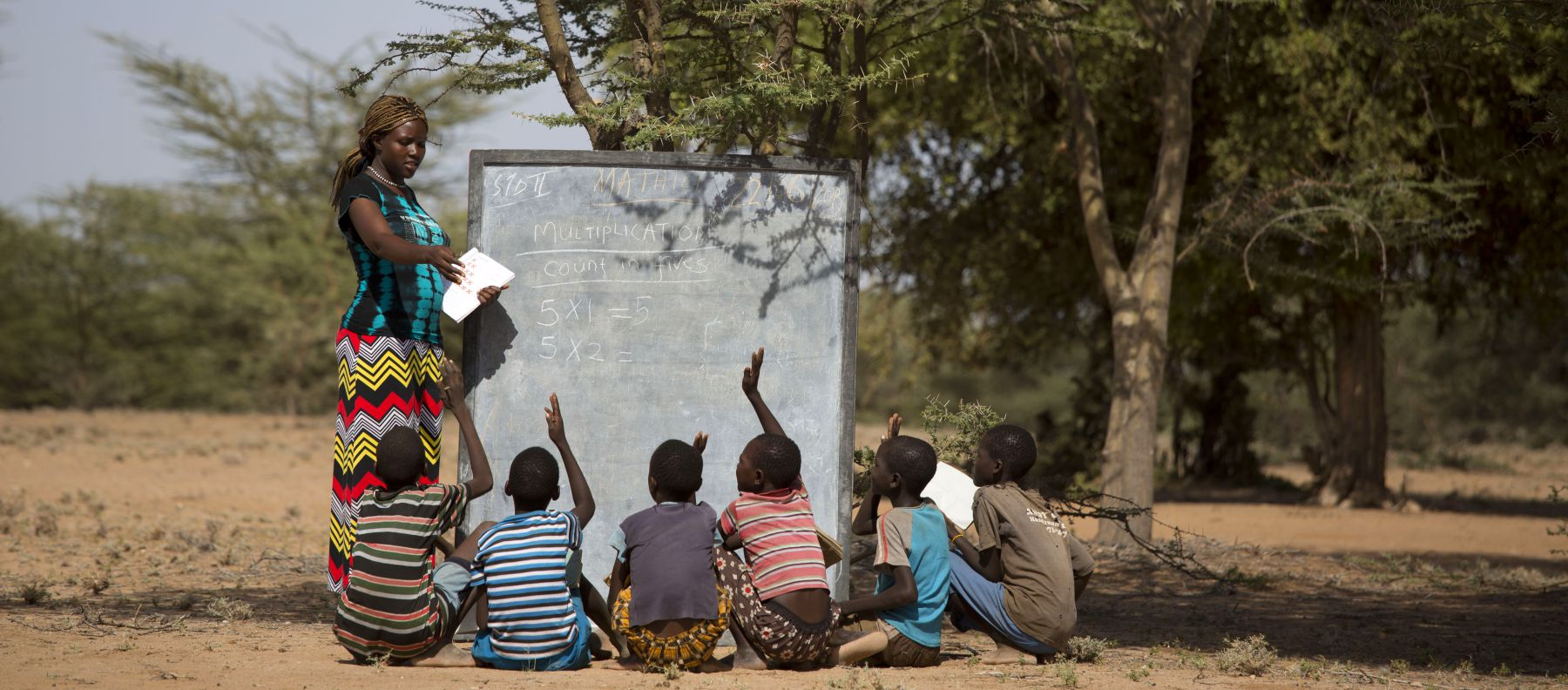 Teaching under a tree in a mobile school in Turkana, Kenya.