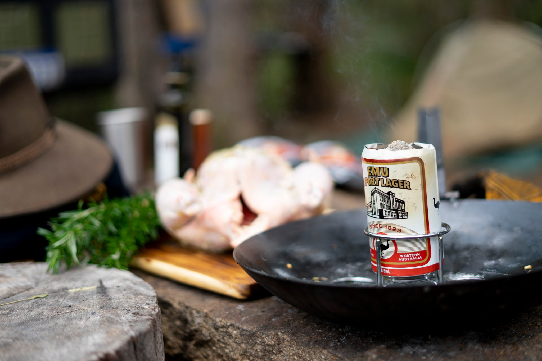 beer can chicken is easier than you think. you just need to start with really hot beer. the steam from the beer is what seals the chickens cavity and locks in the yummy juices.