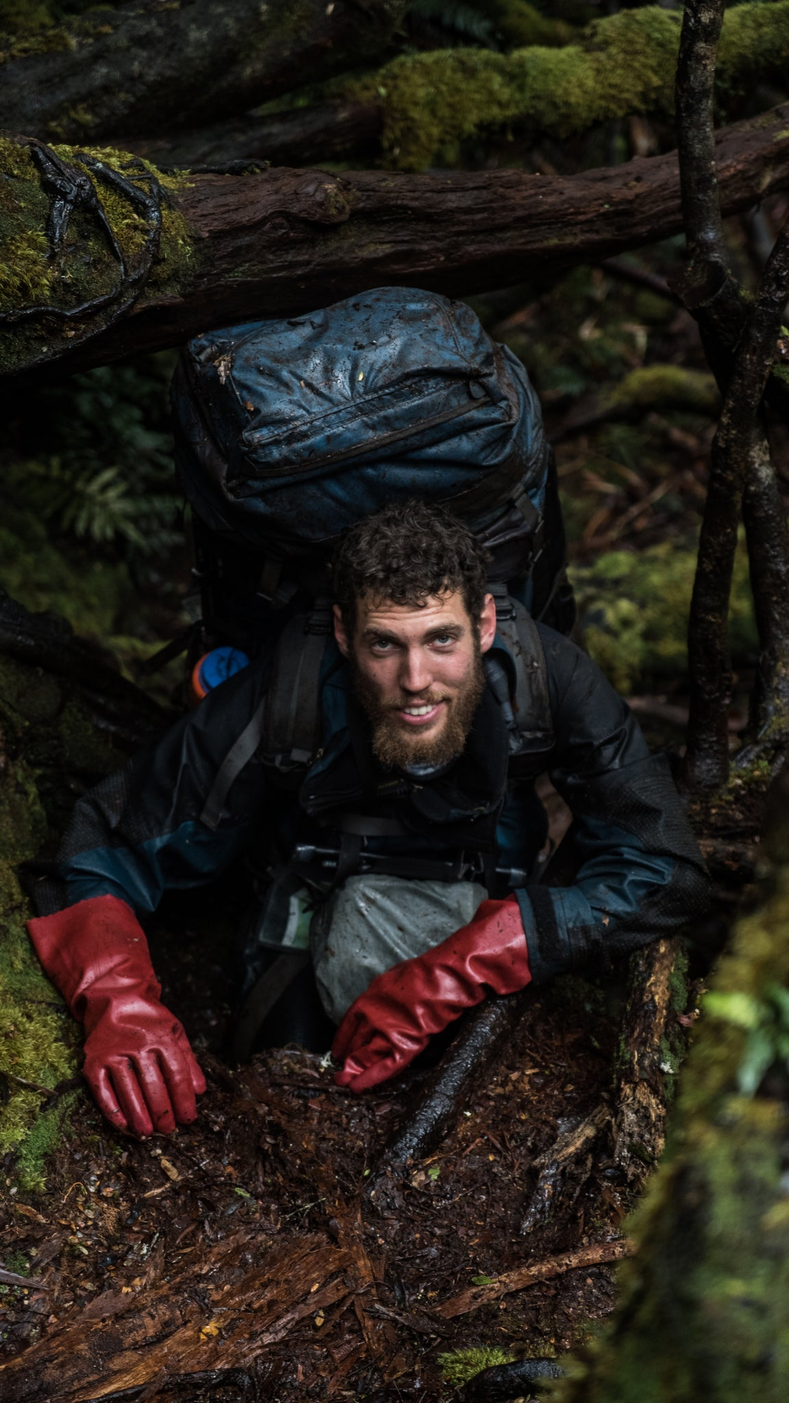 Andy Szollosi climbing in Tasmania into know where carrying a 45 kilo pack. This photo from one of TASPARKS trails in the wilderness of Tasmania when filming Winter on the Blade. Hiking in Tasmania is a passion of Andy's and carrying in  his camera gear to capture these rugged landscapes and epic adventures is what we love about Andy Szollosi. Winter on the Blade is one of the most epic films following a crew of climbers in Tasmania tackling Federation Peak. This film has been aired around the world through the Banff Mountain Film Festival 2018.
