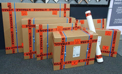 framed and unframed reproductions packaged in cardboard boxes ready for shipping