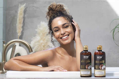woman with coconut milk shampoo and conditioner