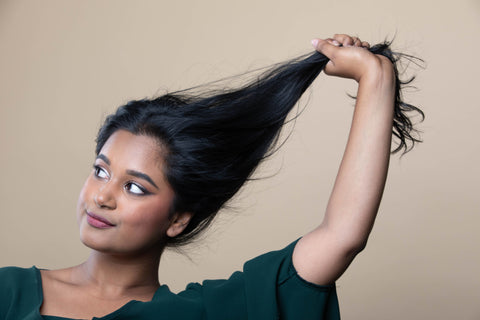 indian woman holding hair
