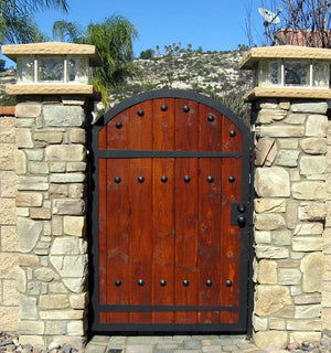 Decorative hardware used on a wooden entrance gate. Simple to install, great for us on the interior as well as the exterior of the home. Choose from a wide variety, all of which are handmade and hand painted. Shop online at www.doorstuds.co.za