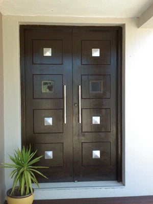 Front door with custom NW/105DD decor hardware square studs to give a gothic / rustic look. Decorative hardware made easy