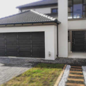 Double garage and front door featuring NW/93DD CH chrome studs