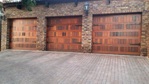 3 single garage doors all featuring NW/AC25 mock knockers and NW/AC6 mock hinges.