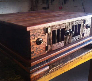 Sleeper wood coffee table finished off with NW/60DD coach bolt heads.