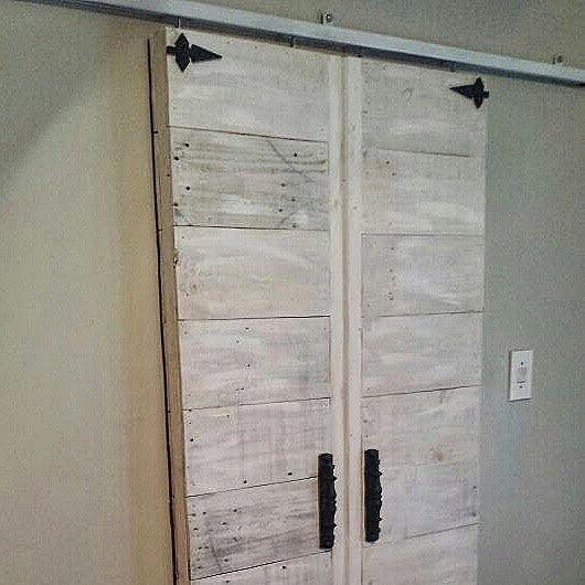 Recycled pallet wood sliding doors with NW/AC14 spears/mock hinges and NW/AC2 mock handles.