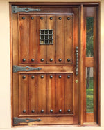 Rustic pivot door with NW/AC6 mock hinges 500 mm long, NW/AC32 door grille and NW/93DD 50 mm plain round cap studs.