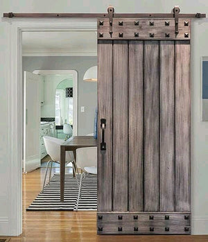 Barn style sliding door with studs to give it that authentic look and feel
