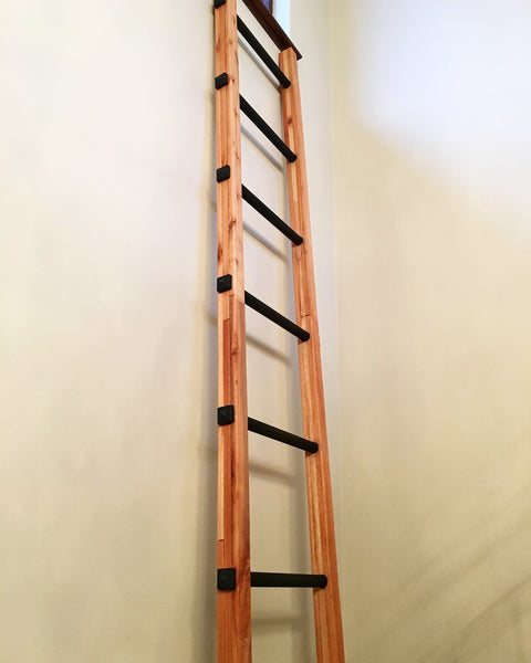 Ladder turn lighting fixture with decorative resin studs