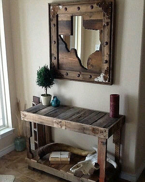 Recycled pallet wood mirror frame customised with decoractive studs