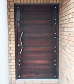 Customised front door with #doorstuds using the NW/93DD chrome round decor stud
