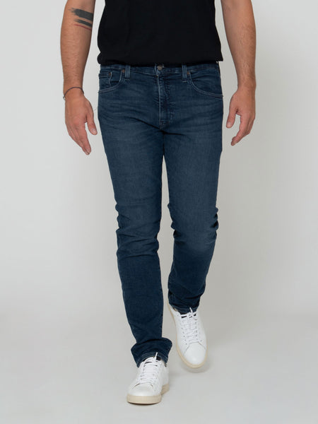 512 slim taper denim scuro