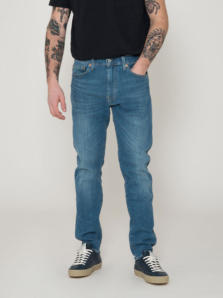 512 slim taper fit denim medio chiaro