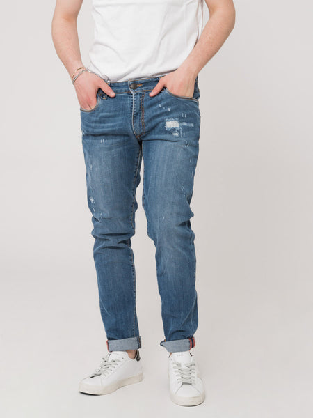 Jeans Tom Log In denim medio strappato