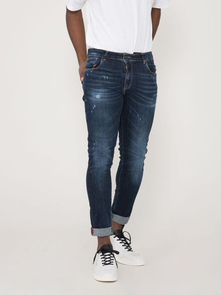 Jeans tom scuri con strappi