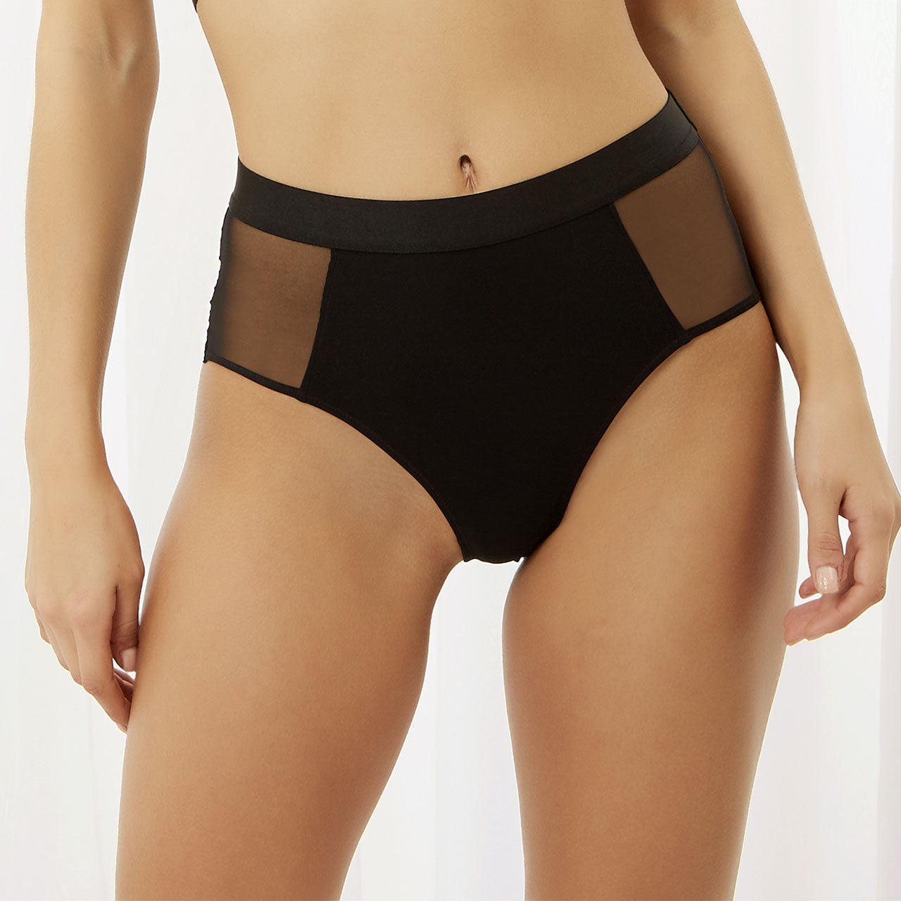 On trend high waisted mesh brief with provocative lace up detail on the back. Softly elasticated legline and a wide elastic waistline give a perfect fit and feel. Style with the matching Fenella bra for an edge on trend statement look.