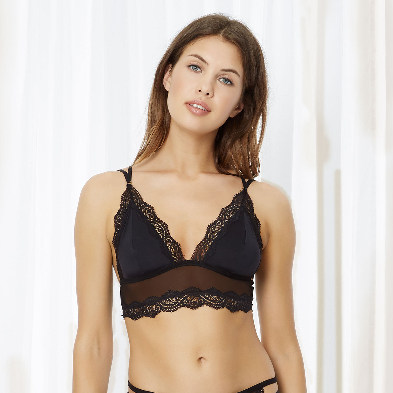 Make a statement in this stunning longline bralette designed to be seen. Delicate mesh hugs the figure whilst the opulent lace trimming enhances the bust creating a flirtatious feel to the look. Multiple directional strapping across the back further helps to accentuate and flatter the shoulder line, whilst also creating an edgier feel. This bralette also does not feature any fastenings giving it a more smooth and comfortable finish. Style with your fave statement jewellery for the ultimate go-to festival look.
