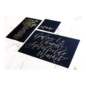 navy table name card, seating chart and place card with gold calligraphy