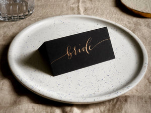 black wedding place card with copper calligraphy 2