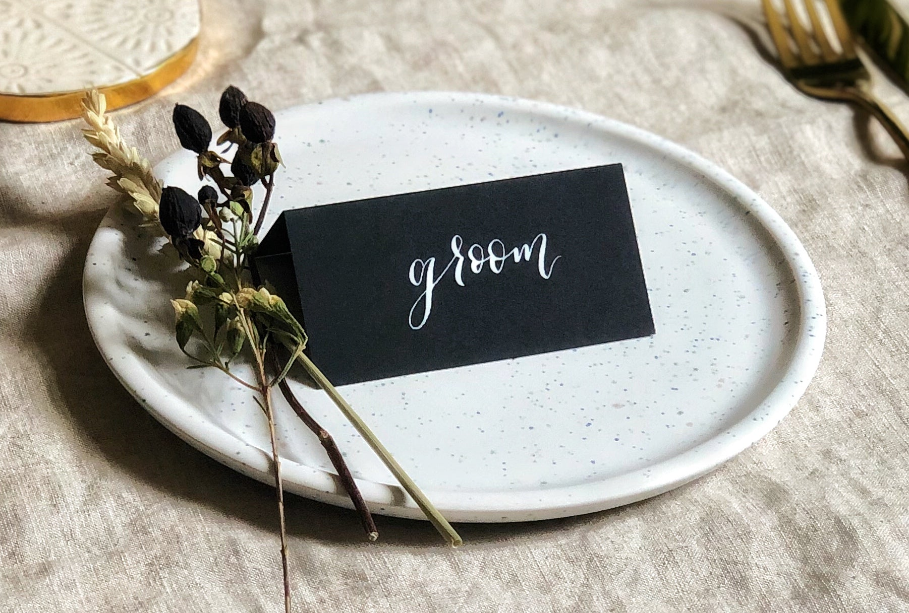 black wedding place card with white calligraphy 2