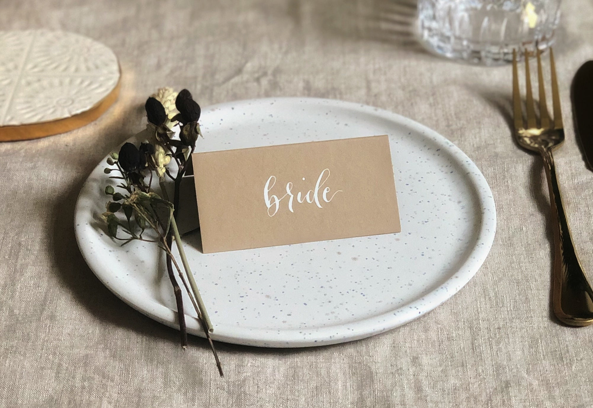 natural coloured wedding place cards with white calligraphy 2