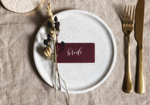 burgundy wedding place card with white calligraphy