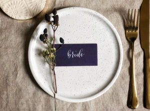 purple wedding tent-fold place card with white calligraphy