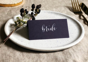 purple wedding tent-fold place card with white calligraphy 2