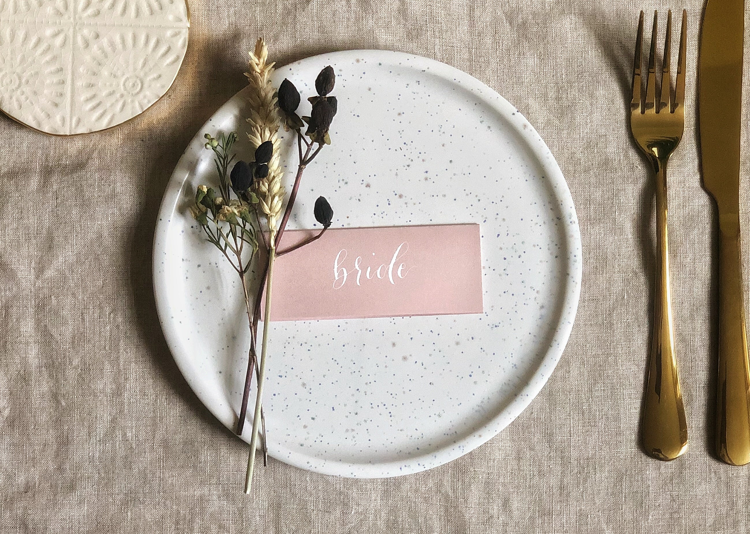 dusty pink wedding place card with white calligraphy