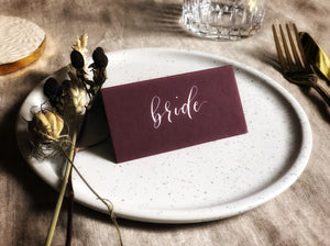 burgundy wedding place card with white calligraphy 2