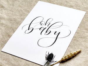 art print with 'oh baby' written in black modern calligraphy on a white background