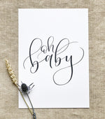 art print with 'oh baby' written in black modern calligraphy on a white background 2