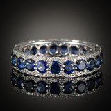 "<span class=""subtitlerp"">Romancína Collection</span><br /><br />Blue Sapphire and Diamond Eternity Ring"