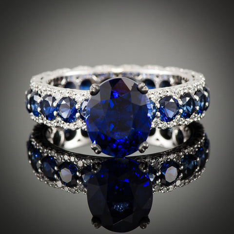 "<span class=""subtitlerp"">Romancína Collection</span><br /><br />Oval Sapphire & Diamond Ring"