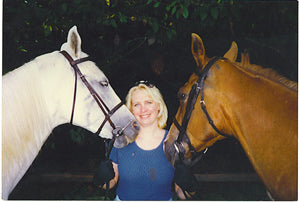 photo of Sandy Taz with horses