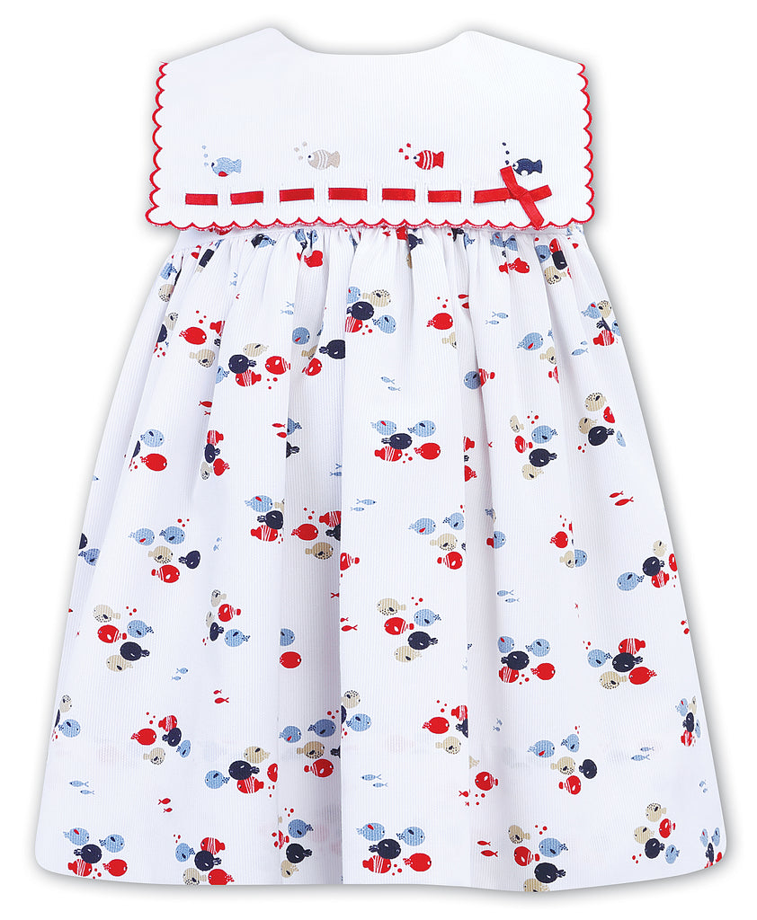 Sarah Louise of England fish print dress with bib collar and red ribbon