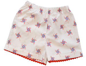 peggy green girls two pocket short in pin wheel print