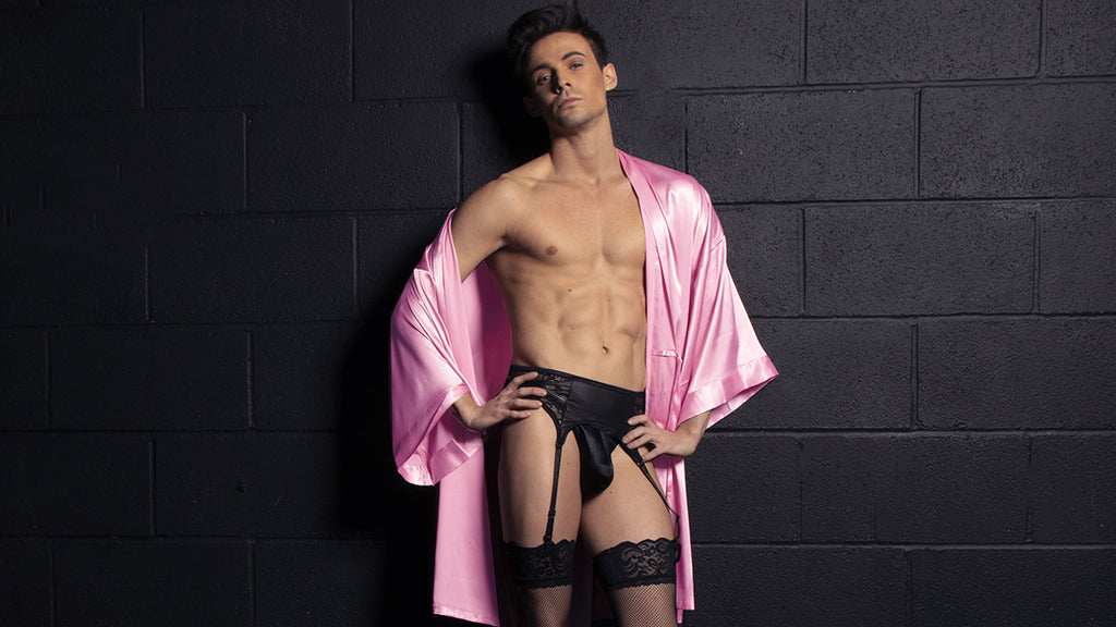 man wearing pink satin robe garter and stockings