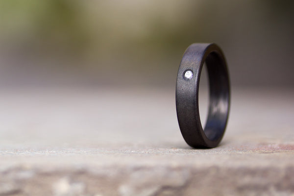 Graphite and carbon fiber inside ring with Swarovski (01100_4S)