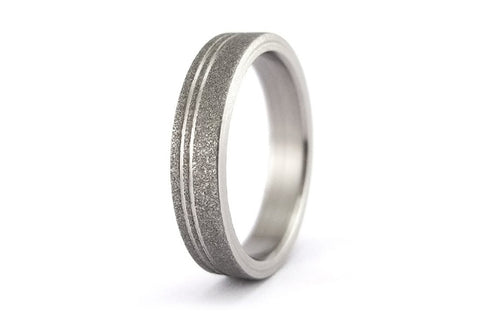 Sandblasted titanium ring with polished inlays (00013_4N)