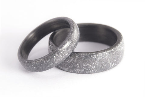 Carbon fiber and silver resin wedding bands. (01304_4N7N)