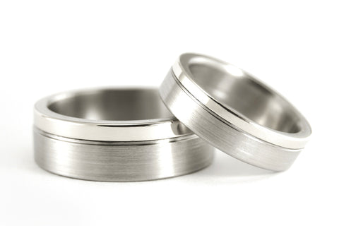 18ct white gold and titanium wedding bands (00557_4N7N)