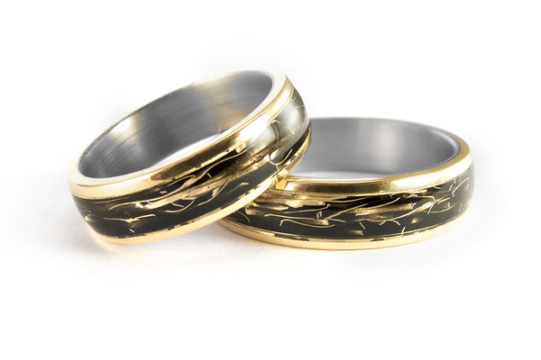 18ct yellow gold and titanium wedding bands (04706_5N6N)