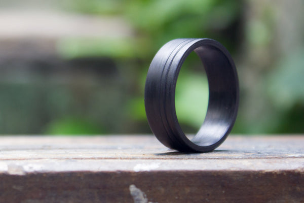 Men's undirectional carbon fiber ring. Unique black wedding band with two stripes. (00123) - Rosler Rings