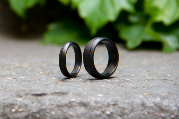 Set of two carbon fiber round wedding bands. Unique and modern black rings. (00103) - Rosler Rings