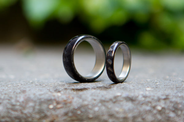 Set of two titanium and carbon fiber wedding bands. Unique black glossy rings. (00317) - Rosler Rings