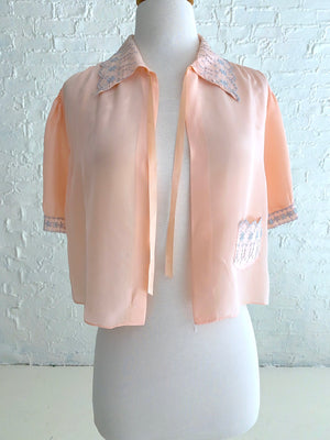 Light Pink Rayon Shrug with Light Blue Eyelet Detail and Front Pocket